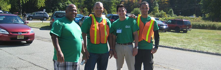 Volunteers direct traffic at a ReStore sale