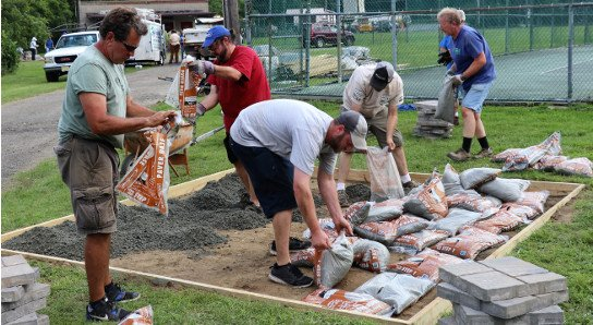 Lowe's volunteers building patio in Arbolino Park in Netcong